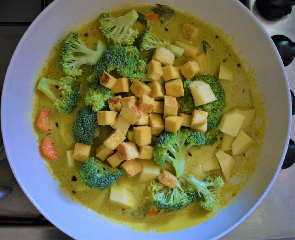 Add vegetables and tofu to the coconut curry sauce