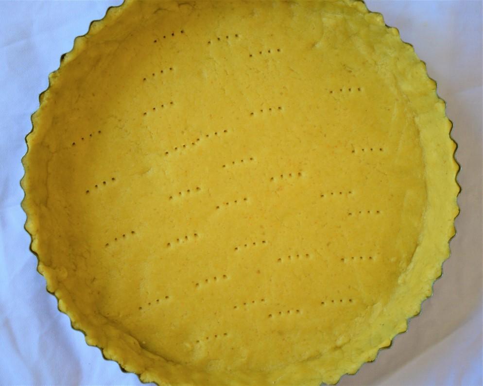 Pie dough fit into the tin