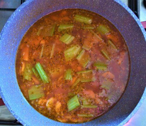 Red lentil soup ingredients in a pot