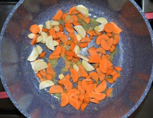 Saute carrots and parsley root with garlic and onion