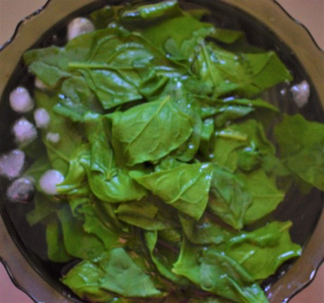 Blanch and cool the spinach in ice water