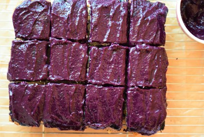 Vegan blueberry coconut cake cut into squarescut into squares