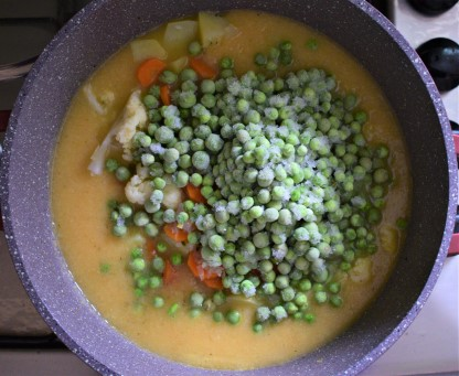 Cauliflower, potato, green pea soup preparation