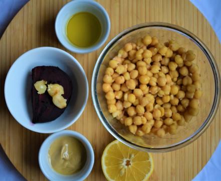 Roasted beetroot hummus ingredients prepared to be blended in a food processor