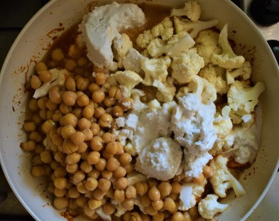 Sweet potato, cauliflower and chickpea curry cooked in a wok