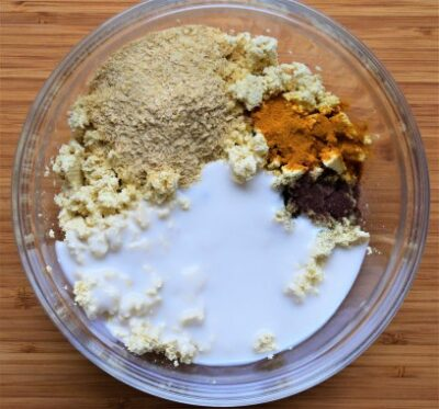 Tofu scramble ingredients in a bowl to be mixed