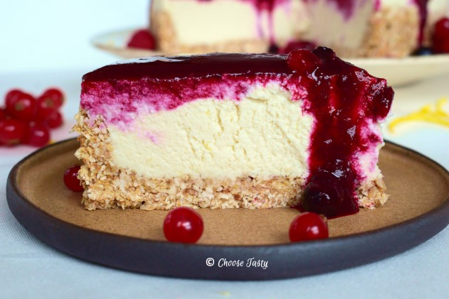 No-bake vegan cheesecake served with berry sauce