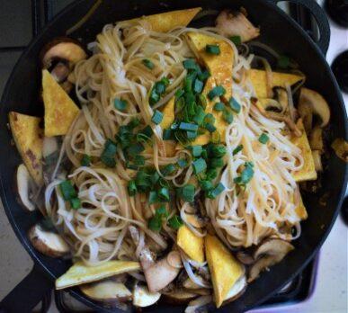 Mushroom tofu stir fry noodles cooked in a pan