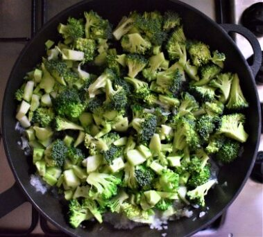 Broccoli florets cooked with onion