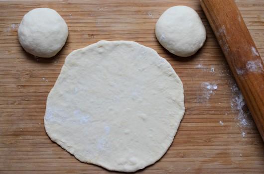 Greek pita dough rolling