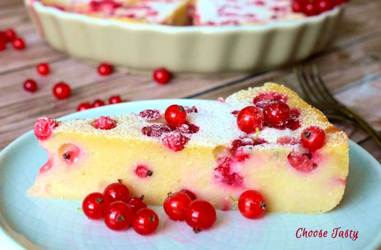 Red currant clafoutis served with powdered sugar
