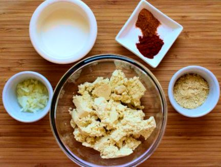 Spread ingredients: firm tofu, soy cream, diced onion, nutritional yeast, smoked paprika, chili powder