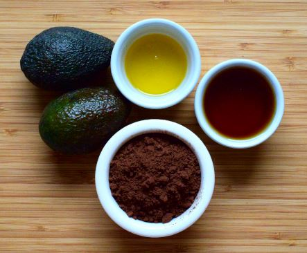 Chocolate mousse ingredients: avocado, cocoa powder. cocoa butter, maple syrup