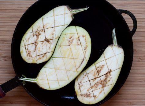 Half cut eggplants ready to pan roast