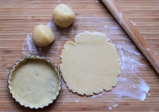 Roll and model the dough into the tart pans