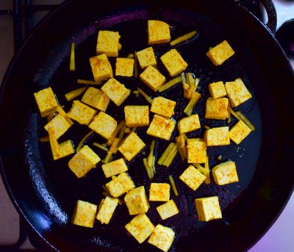 Fried tofu with turmeric and ginger